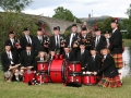 Sierra Highlanders Pipe Band in front of Stirling Bridge in Stirling, Scotland - August 2005