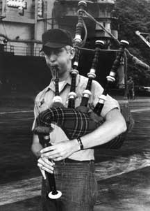 Sean Cummings piping on the USS Midway